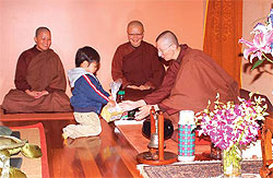 Giving alms to the abbot and learning that it is possible to practise in an all-woman environment with female dharma teachers. Photo © Dhammasara Nuns Monastery.