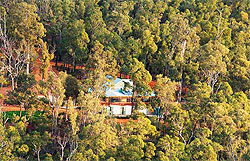The Dhammasara Nuns Monastery in Perth, Australia is surrounded by lush greenery.